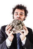 Businessman lifting a heavy stone Stock Photos