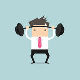 Businessman lifting a heavy weight Stock Photos