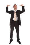 Businessman lifting his arms Stock Image