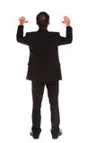 Businessman lifting his arms Stock Images