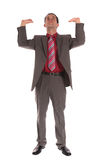 Businessman lifting his arms Royalty Free Stock Photos