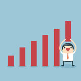 Businessman lifting increase graph Stock Images