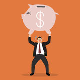 Businessman lifting a piggy bank. Business concept Stock Image
