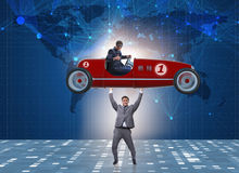 The businessman lifting sports car in power concept Royalty Free Stock Image