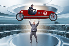 The businessman lifting sports car in power concept Stock Photos