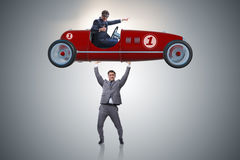 The businessman lifting sports car in power concept Royalty Free Stock Photography