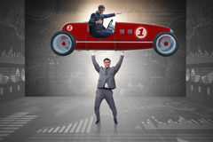 The businessman lifting sports car in power concept Stock Photography