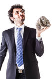 Businessman lifting a stone Stock Photography