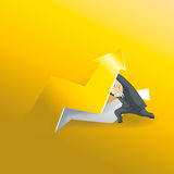 Businessman lifting up gold arrow Royalty Free Stock Image