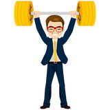 Businessman Lifting Up Money. Happy successful businessman lifting up barbell with golden dollar coin weight Stock Image