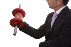 Businessman lifting weights. (isolated on white stock photography