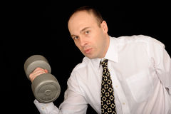 Businessman lifting weights Stock Photos
