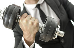 Businessman lifting weights Royalty Free Stock Photos