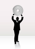 Businessman lifting wheel Stock Photos