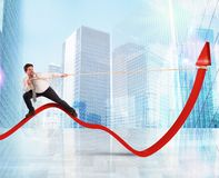 Businessman lifts statistics Stock Photos