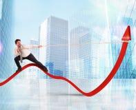 Businessman lifts statistics Stock Photo