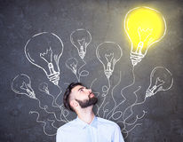 Businessman with lighbulb drawings Royalty Free Stock Photo