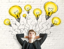 Businessman with lighbulb drawings Stock Photography