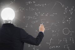 Businessman with lighbulb in head standing and hand drawing. Royalty Free Stock Photos