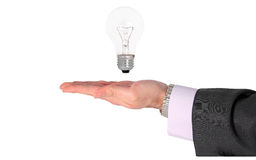Businessman with light bilb Stock Photo