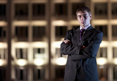 Businessman and light building at night city Royalty Free Stock Images