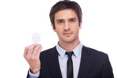 Businessman with light bulb. Stock Image