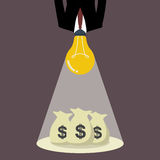 Businessman with a light bulb head glow to the money bags Royalty Free Stock Image