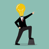 Businessman with a light bulb head pointing up Royalty Free Stock Photography