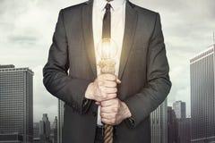 Businessman with light bulb Stock Photos