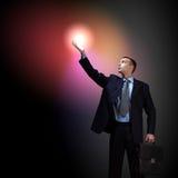 Businessman with light shining Stock Photo