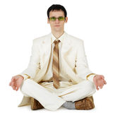 Businessman in light suit - original way relaxes Stock Photo