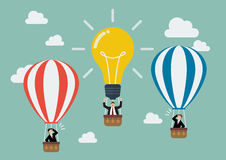 Businessman in lightbulb balloon fly pass his competitor Stock Photos
