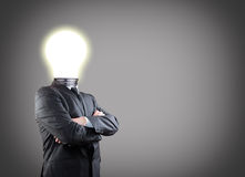 Businessman with lightbulb Royalty Free Stock Photo
