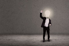 Businessman with lightbulb head raised arm Royalty Free Stock Photography