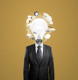 Businessman with lightbulb i Royalty Free Stock Photography