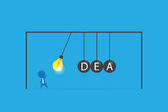 Businessman with lightbulb and idea word on balancing balls newton`s cradle, idea and business concept stock illustration