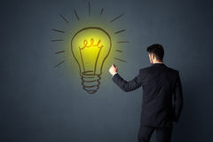 Businessman with lightbulb Stock Photography