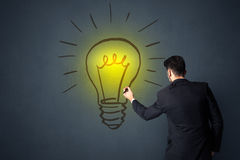 Businessman with lightbulb Royalty Free Stock Image