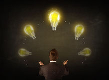 Businessman with lightbulbs over his head Royalty Free Stock Image