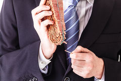 Businessman lighting firecrackers with match Stock Images