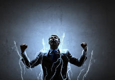 Businessman with lightning stock photography