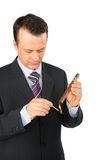 Businessman lights a cigar Royalty Free Stock Photos