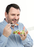 Businessman likes takeaway salad Stock Photography