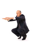 Businessman limbering up. Isolated on white Royalty Free Stock Images