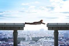 Businessman linking broken bridge. Above city scape Royalty Free Stock Photos