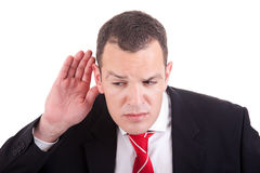 Businessman listening Stock Images