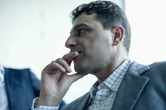 Businessman listening in a business meeting Stock Photo