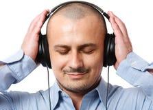 Businessman listening music Royalty Free Stock Photo