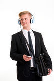 Businessman listening music with blue hadphone Stock Photos