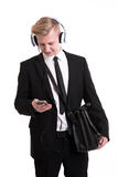 Businessman listening music with blue hadphone Royalty Free Stock Image